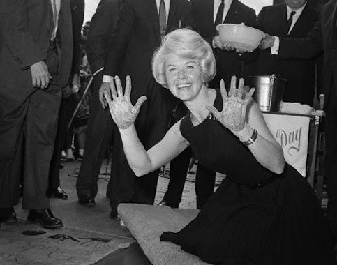 By now Doris was an international star and was honored with her hand prints at Grauman's Chinese Theater.